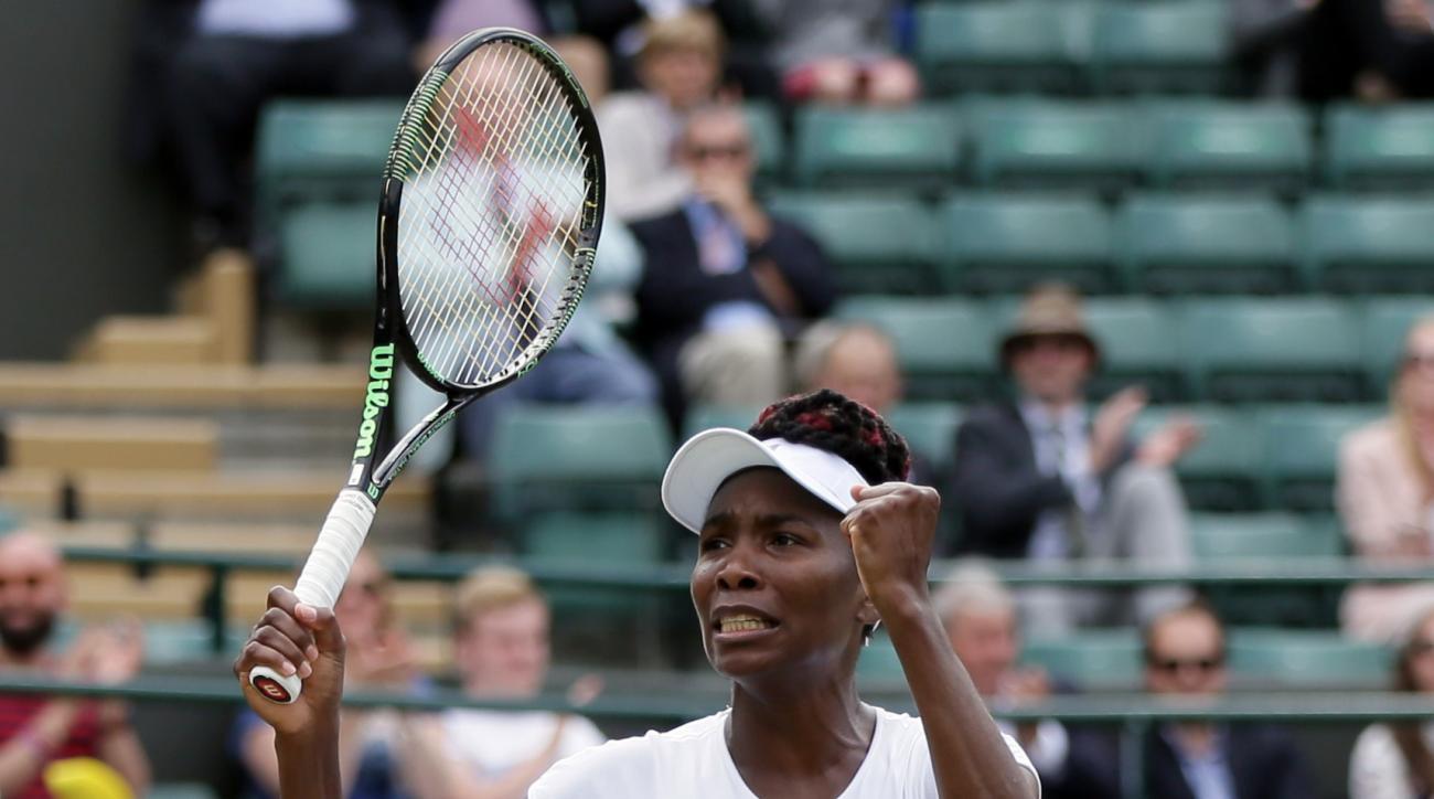Venus Williams of the U.S celebrates after beating Yaroslava Shvedova of Kazahkstan in their women's singles match on day nine of the Wimbledon Tennis Championships in London, Tuesday, July 5, 2016. (AP Photo/Tim Ireland)