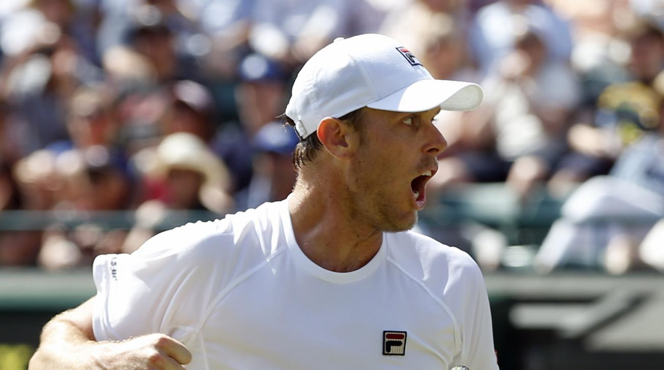 Sam Querrey of the U.S celebrates a point against Milos Raonic of Canada during their men's singles match on day ten of the Wimbledon Tennis Championships in London, Wednesday, July 6, 2016. (AP Photo/Alastair Grant)