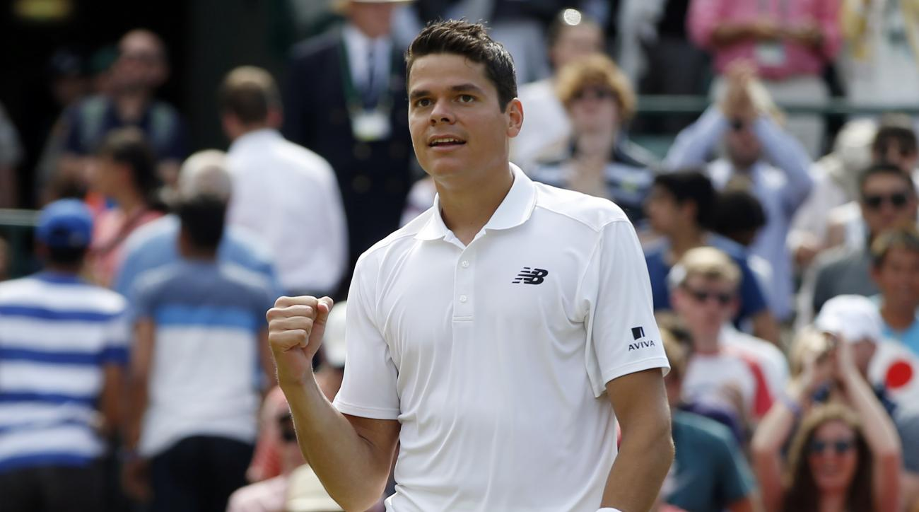 Milos Raonic of Canada celebrates at match point after beating Sam Querrey of the U.S in their men's singles match on day ten of the Wimbledon Tennis Championships in London, Wednesday, July 6, 2016. (AP Photo/Alastair Grant)