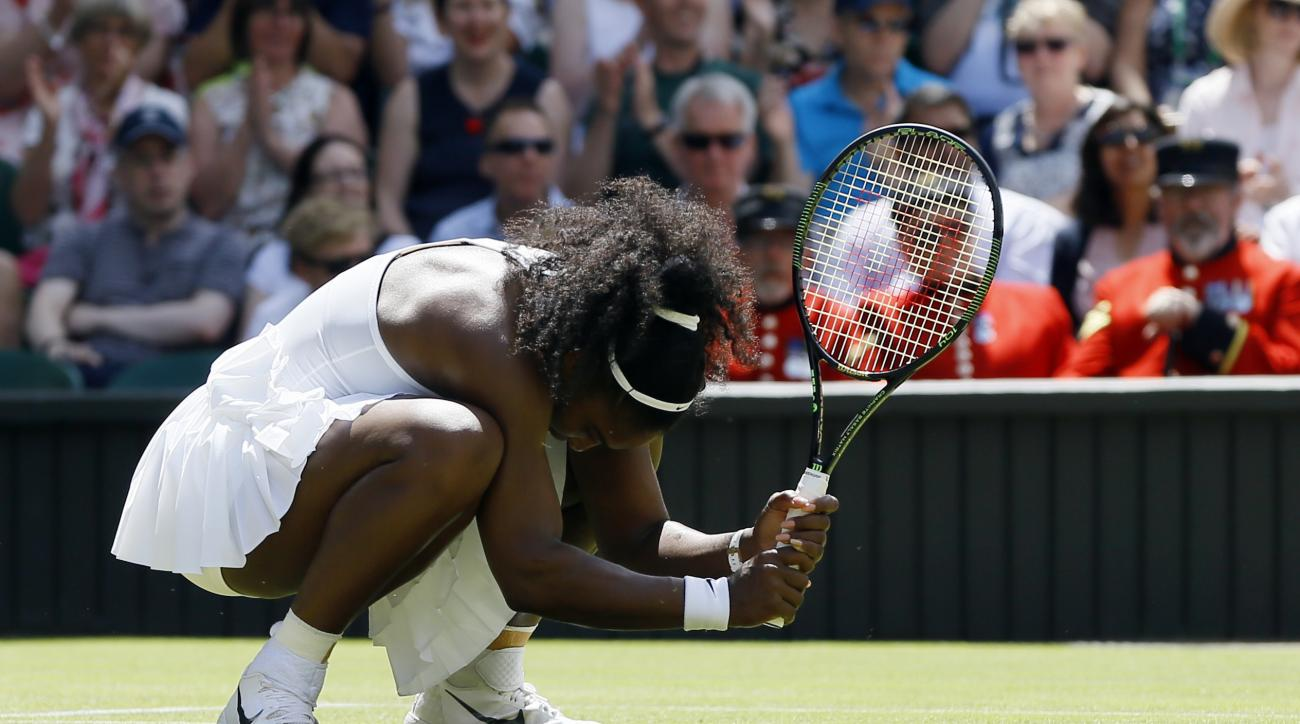 Serena Williams of the U.S reacts during her women's singles match against Elena Vesnina of Russia on day eleven of the Wimbledon Tennis Championships in London, Thursday, July 7, 2016. (AP Photo/Kirsty Wigglesworth)