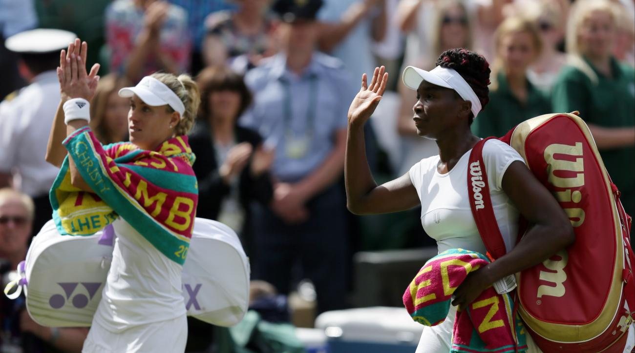 Angelique Kerber of Germany, left, walks off court with Venus Williams of the U.S after beating her in their women's singles match on day eleven of the Wimbledon Tennis Championships in London, Thursday, July 7, 2016. (AP Photo/Tim Ireland)