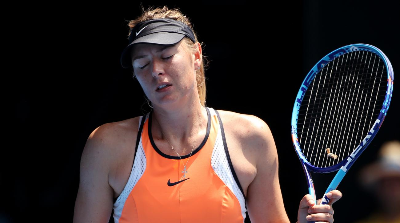 FILE - In this Tuesday, Jan. 26, 2016 file photo, Maria Sharapova of Russia loses a point to Serena Williams of the United States during their quarterfinal match at the Australian Open tennis championships in Melbourne, Australia. A ruling by the Court of