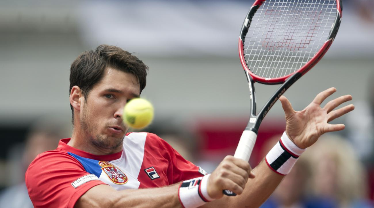 Serbia's Dusan Lajovic returns a ball to Britain's James Ward during their Davis Cup quarterfinal tennis match in Belgrade, Serbia, Saturday, July 16, 2016. (AP Photo/Marko Drobnjakovic)