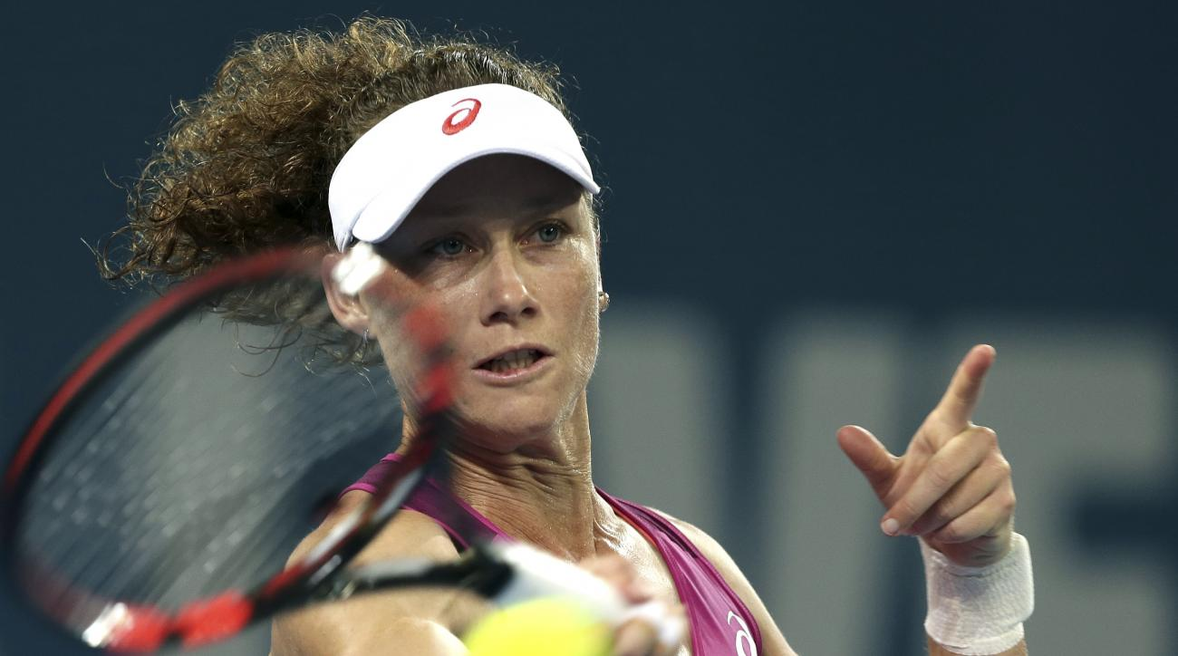 Sam Stosur of Australia plays a shot in her 2nd round match against Carla Suarez Navarro of Spain during the Brisbane International tennis tournament in Brisbane, Australia, Tuesday, Jan. 5, 2016. (AP Photo/Tertius Pickard)