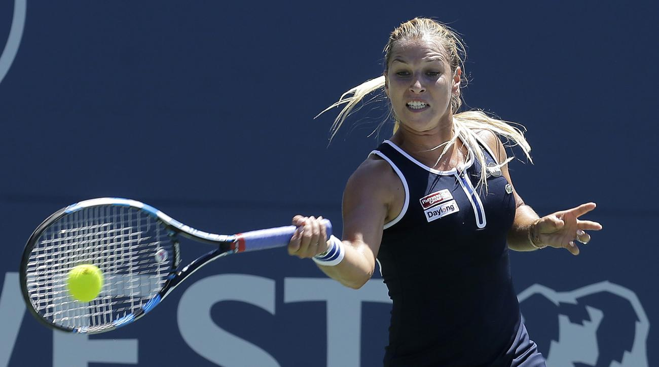 Dominika Cibulkova, of Slovakia, returns to Johanna Konta, of Britain, during a semifinal in the Bank of the West Classic tennis tournament in Stanford, Calif., Saturday, July 23, 2016. (AP Photo/Jeff Chiu)