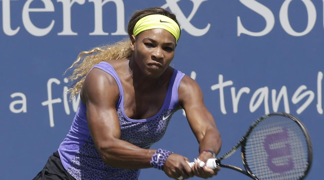 FILE - In this Aug. 13, 2014, file photo, Serena Williams hits a backhand against Samatha Stosur, from Australia, during a match at the Western & Southern Open tennis tournament in Mason, Ohio. Williams has pulled out of the 2016 Rogers Cup because of sho