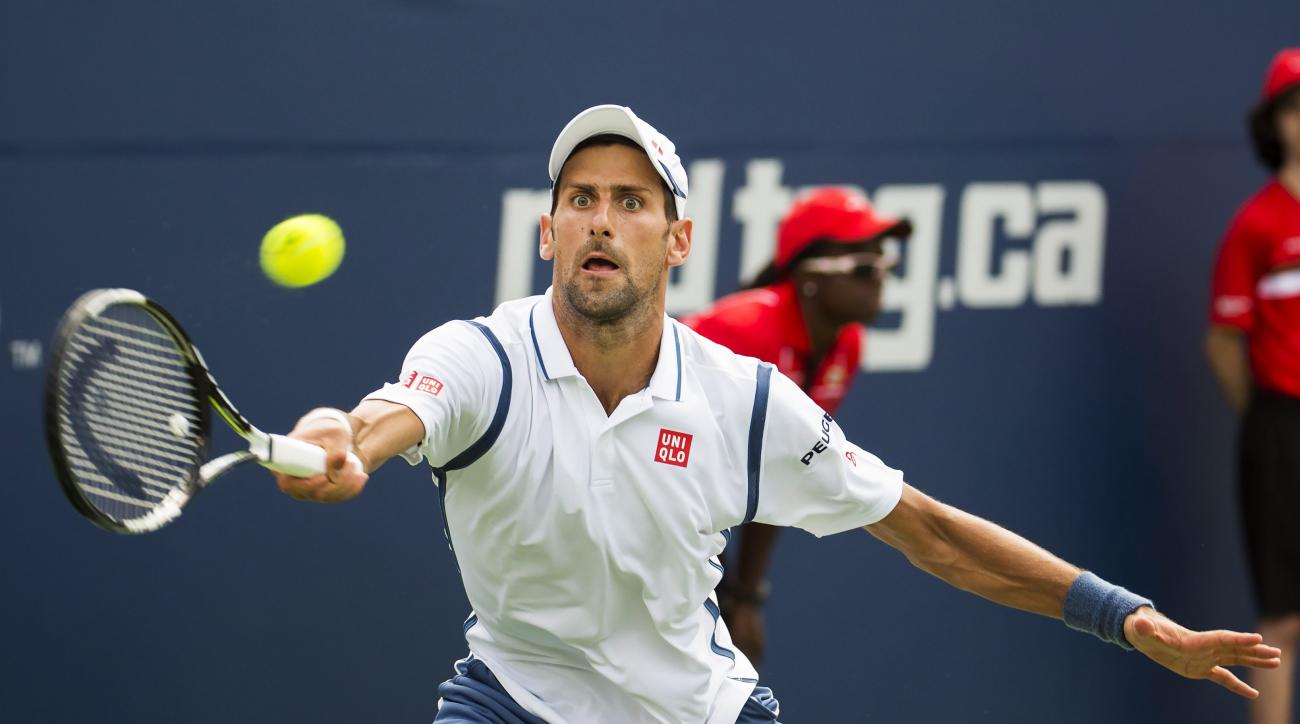 Novak Djokovic of Serbia returns the ball during men's second round Rogers Cup tennis action in Toronto on Wednesday, July 27, 2016. (Nathan Denette/The Canadian Press via AP)