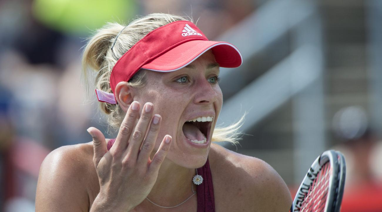 Angelique Kerber, of Germany, reacts during a play in her match with Simona Halep, of Romania, during women's semifinal Rogers Cup tennis action, in Montreal on Saturday, July 30, 2016. (Paul Chiasson/The Canadian Press via AP)