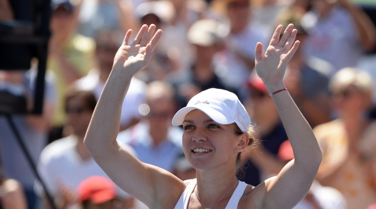 Romania's Simona Halep celebrates her win over Madison Keys, of the United States, during the final of the Rogers Cup tennis tournament, Sunday, July 31, 2016, in Montreal. Halep won 7-6 (2), 6-3. (Paul Chiasson/The Canadian Press via AP)