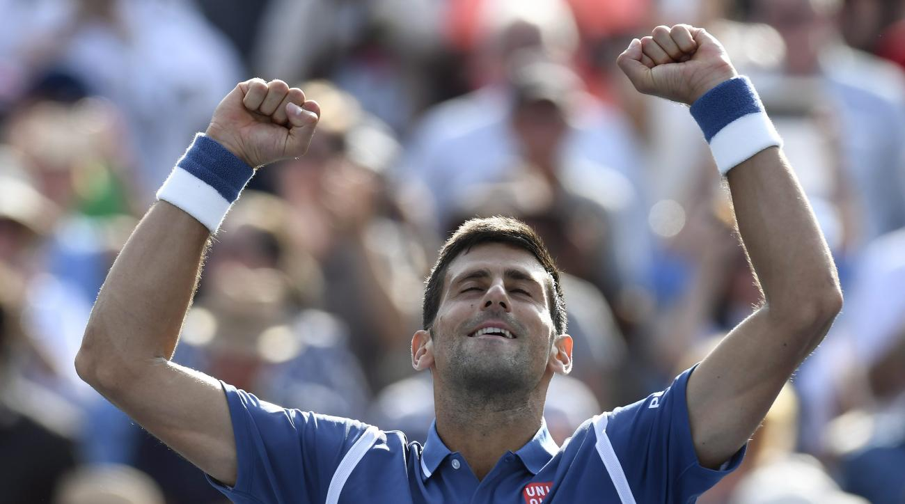 Novak Djokovic, of Serbia, celebrates his win over Kei Nishikori, of Japan, during the men's final of the Rogers Cup tennis tournament, Sunday, July 31, 2016, in Toronto. Djokovic won 6-3, 7-5.(Frank Gunn/The Canadian Press via AP)