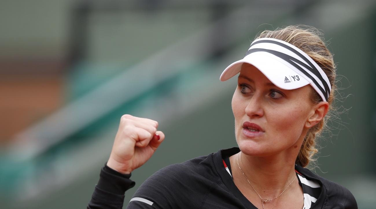 France's Kristina Mladenovic reacts as she plays Italy's Francesca Schiavone  during their first round match of the French Open tennis tournament at the Roland Garros stadium, Tuesday, May 24, 2016 in Paris.  (AP Photo/Alastair Grant)