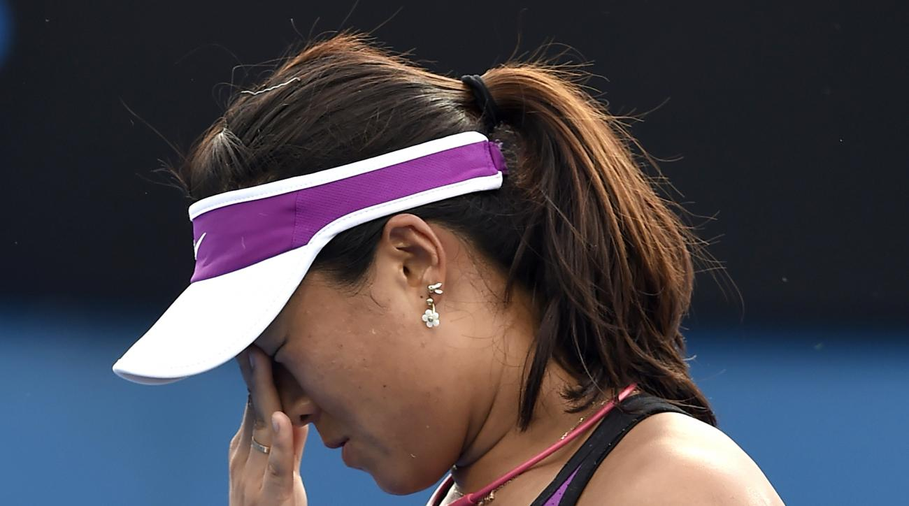 Han Xinyun of China reacts after losing a point to Yulia Putintseva of Kazakhstan during their second round match at the Australian Open tennis championships in Melbourne, Australia, Wednesday, Jan. 20, 2016.(AP Photo/Andrew Brownbill)