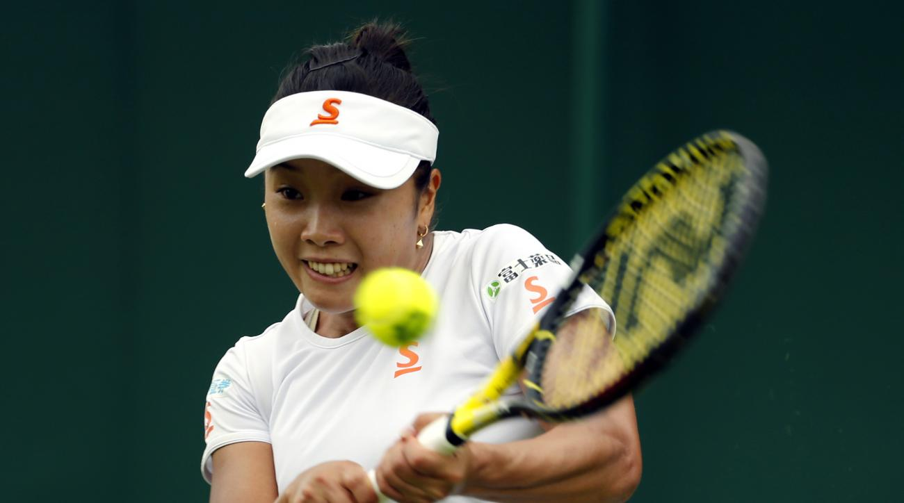 Japan's Kurumi Nara returns to Madison Brengle of the United States during day one of the Wimbledon Tennis Championships in London, Monday, June 27, 2016. (AP Photo/Alastair Grant)