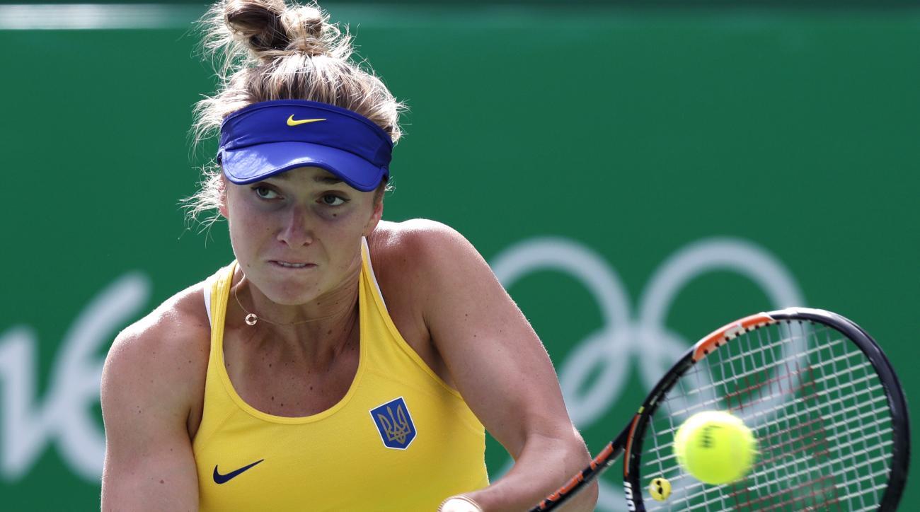 Elina Svitolina, of Ukraine, returns against Petra Kvitova, of the Czech Republic, at the 2016 Summer Olympics in Rio de Janeiro, Brazil, Thursday, Aug. 11, 2016. (AP Photo/Charles Krupa)