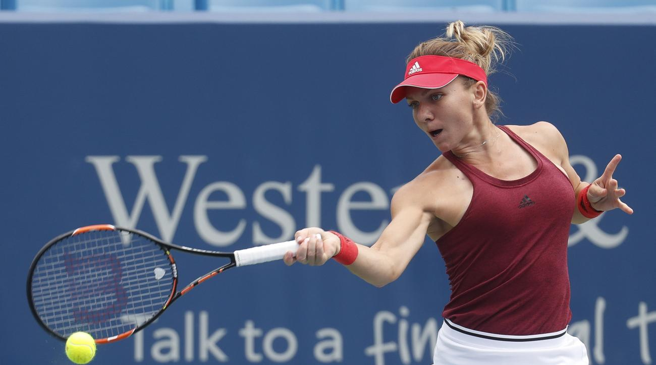 Simona Halep, of Romania, returns to Annika Beck, of Germany, on the fifth day of the Western & Southern Open tennis tournament, Wednesday, Aug. 17, 2016, in Mason, Ohio. (AP Photo/John Minchillo)