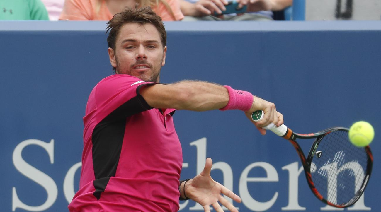Stan Wawrinka, of Switzerland, returns to Jared Donaldson, of the United States, on the fifth day of the Western & Southern Open tennis tournament, Wednesday, Aug. 17, 2016, in Mason, Ohio. (AP Photo/John Minchillo)