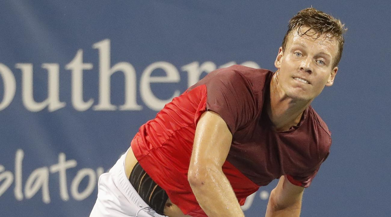 Tomas Berdych, of the Czech Republic, serves to Marcel Granollers, of Spain, during the Western & Southern Open tennis tournament, Wednesday, Aug. 17, 2016, in Mason, Ohio. (AP Photo/John Minchillo)
