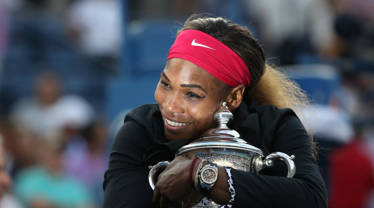 FILE - In this Sept. 7, 2014, file photo, Serena Williams, of the United States, hugs the championship trophy after defeating Caroline Wozniacki, of Denmark, during the championship match of the 2014 U.S. Open tennis tournament, in New York. She is at the