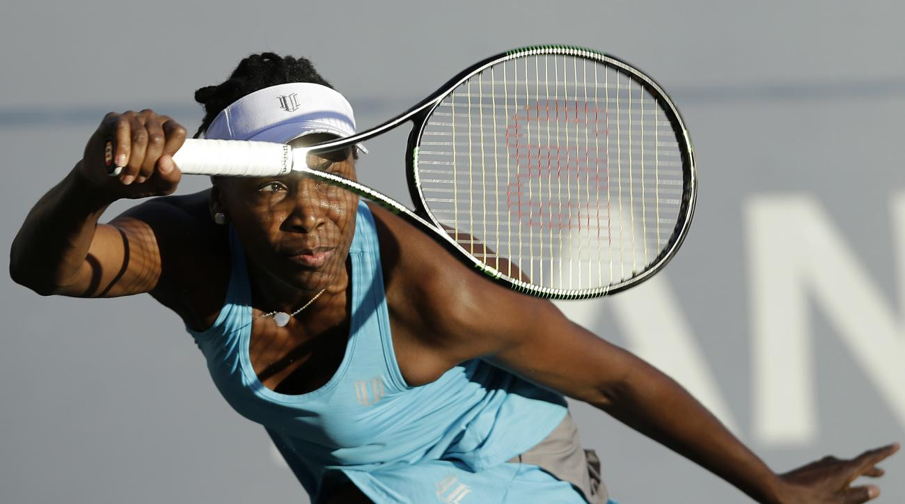 FILE - In this July 23, 2016, file photo, Venus Williams returns to Alison Riske during a semifinal in the Bank of the West Classic tennis tournament in Stanford, Calif. The U.S. Open tennis tournament begins Monday, Aug. 29. (AP Photo/Jeff Chiu, File)