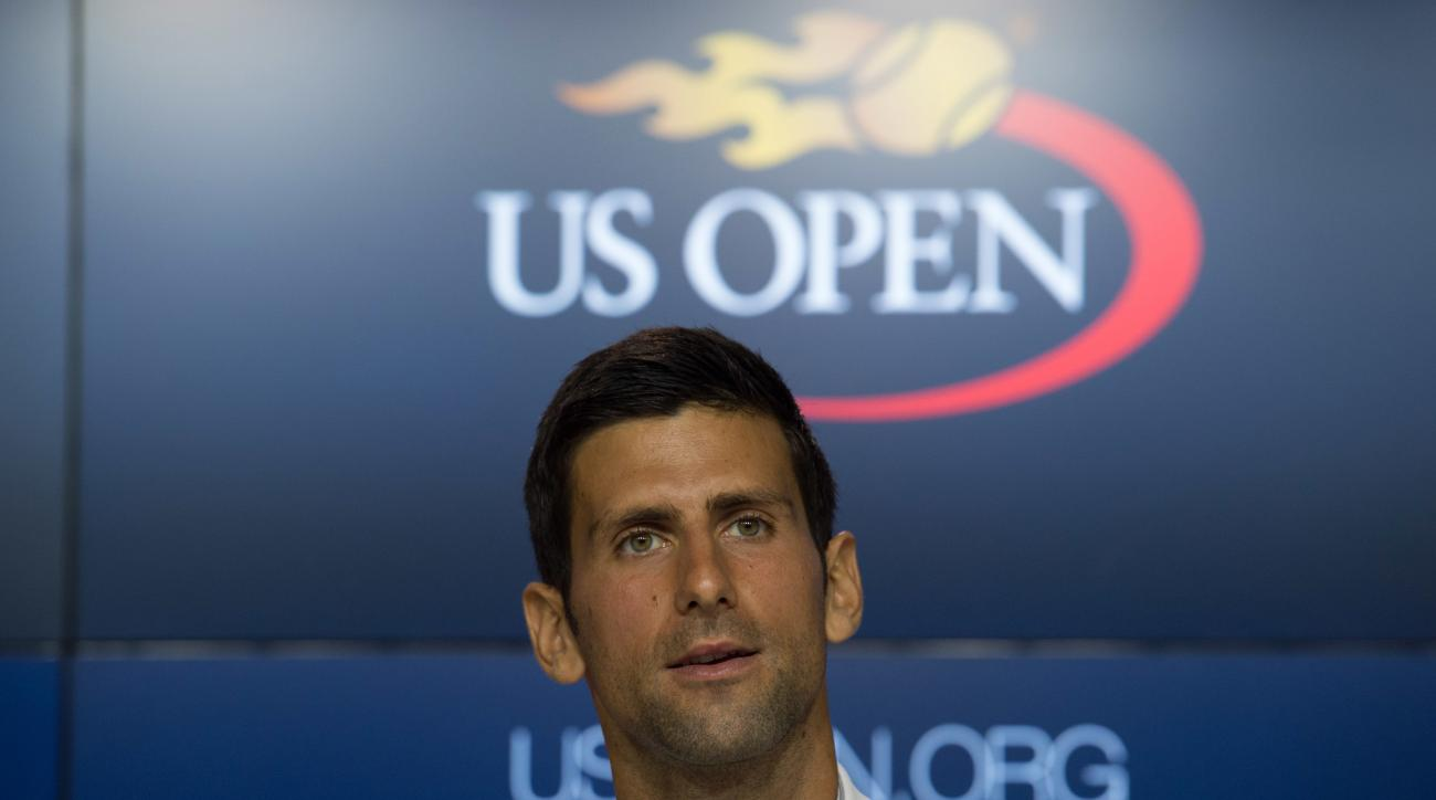 Reigning U.S. Open men's singles tennis champion Novak Djokovic, of Serbia, speaks during a media availability at the Billie Jean King National Tennis Center, Friday, Aug. 26, 2016 in New York. (AP Photo/Bryan R. Smith)