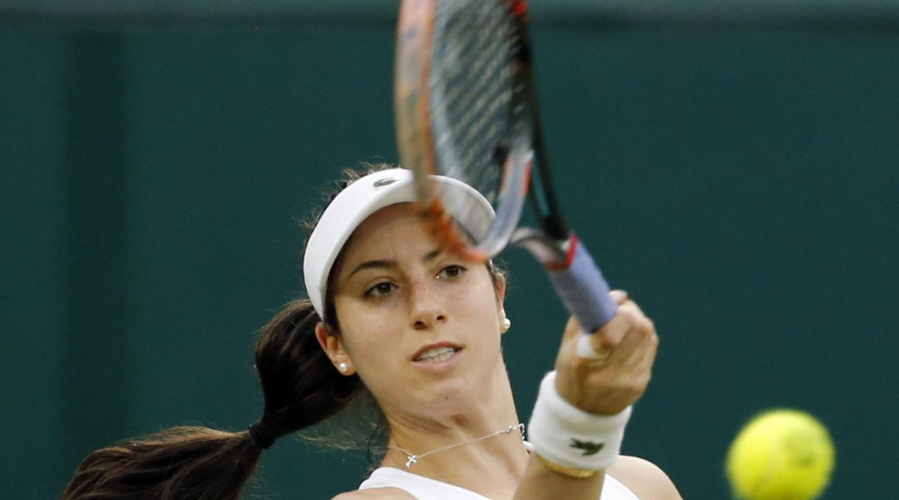 FILE - In this Friday, July 1, 2016, file photo, Christina McHale of the United States, returns to Serena Williams, of the United States, during their women's singles match on day five of the Wimbledon Tennis Championships in London. McHale won a first-se