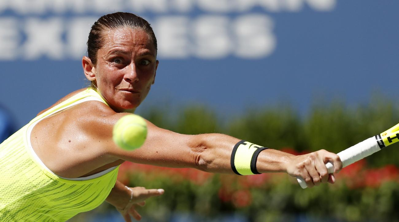 Roberta Vinci, of Italy, returns a shot to Anna-Lena Friedsam, of Germany, during the first round of the US Open tennis tournament, Monday, Aug. 29, 2016, in New York. (AP Photo/Alex Brandon)