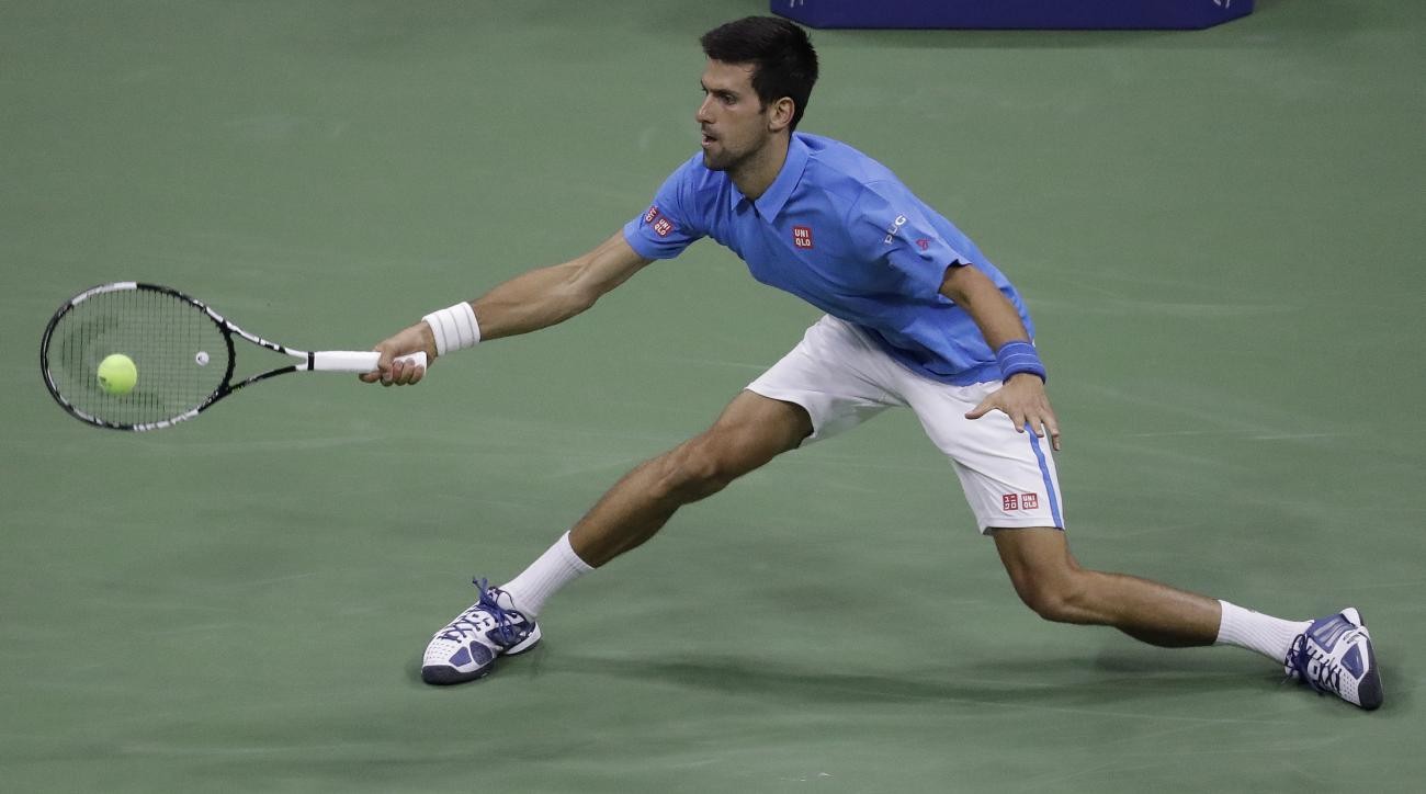 Novak Djokovic, of Serbia, returns a shot to Jerzy Janowicz, of Poland, during the first round of the US Open tennis tournament, Monday, Aug. 29, 2016, in New York. (AP Photo/Julio Cortez)
