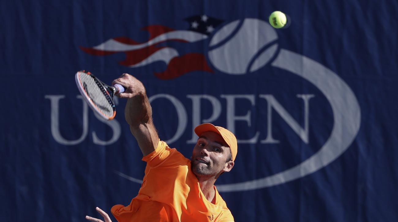 Ivo Karlovic, of Croatia, serves to Yen-Hsun Lu, of Taipei, during the first round of the U.S. Open tennis tournament, Tuesday, Aug. 30, 2016, in New York. (AP Photo/Seth Wenig)