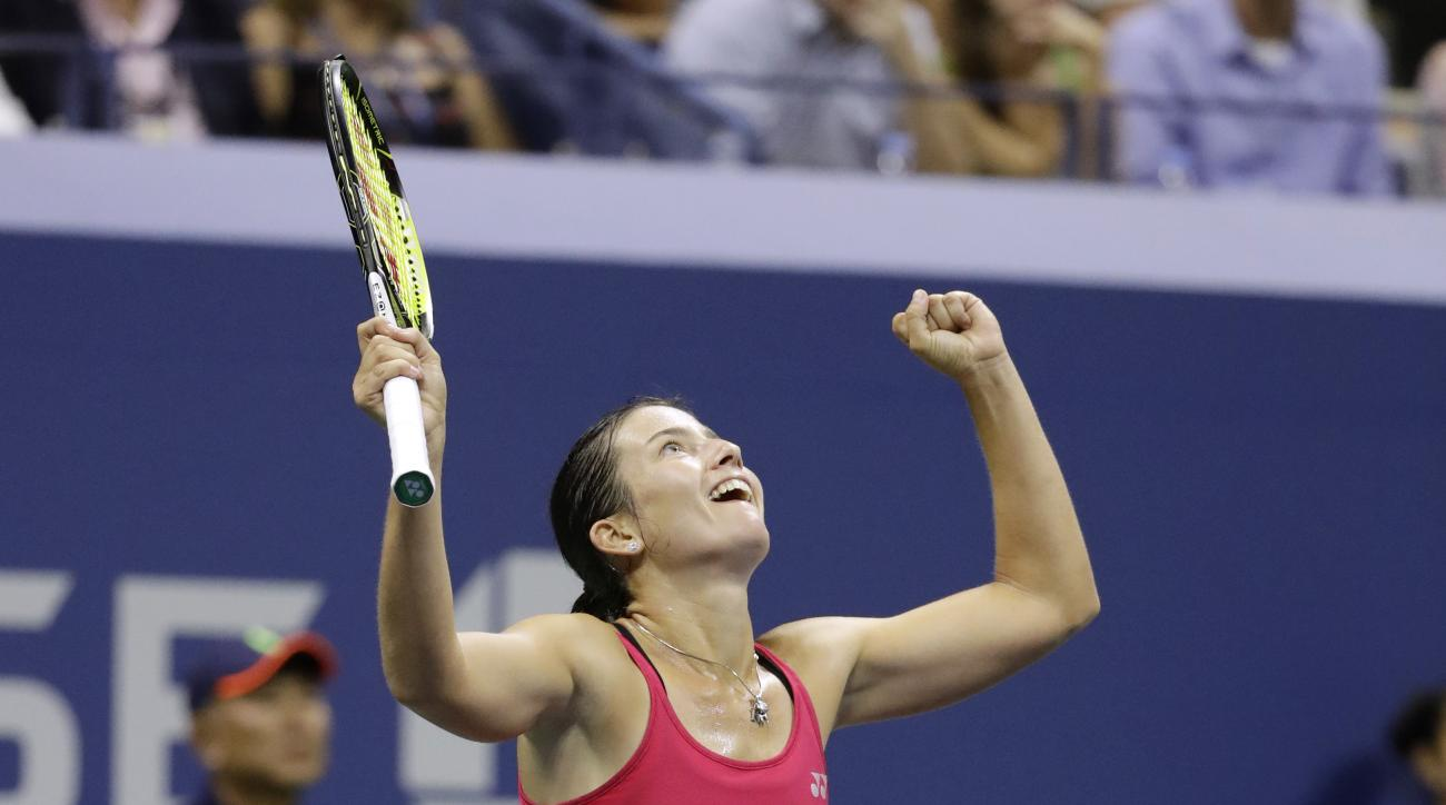 Anastasija Sevastova, of Latvia, reacts after defeating Garbine Muguruza, of Spain, 7-5, 6-4 during the U.S. Open tennis tournament, Wednesday, Aug. 31, 2016, in New York. (AP Photo/Julio Cortez)