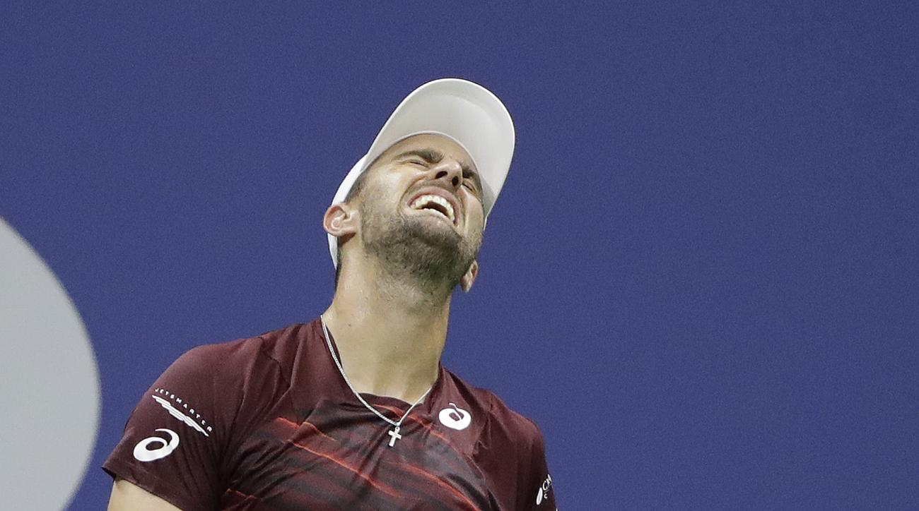 Steve Johnson reacts after missing a shot during his match against Juan Martin del Potro, of Argentina, in the second round of the U.S. Open tennis tournament, Thursday, Sept. 1, 2016, in New York. (AP Photo/Darron Cummings)