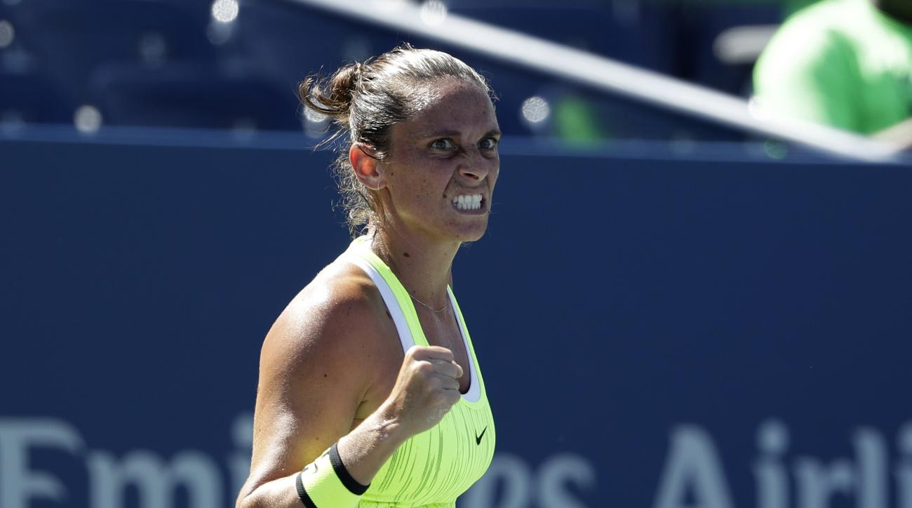 Roberta Vinci, of Italy, reacts after a shot to Carina Witthoeft, of Germany, during the third round of the U.S. Open tennis tournament, Friday, Sept. 2, 2016, in New York. (AP Photo/Seth Wenig)