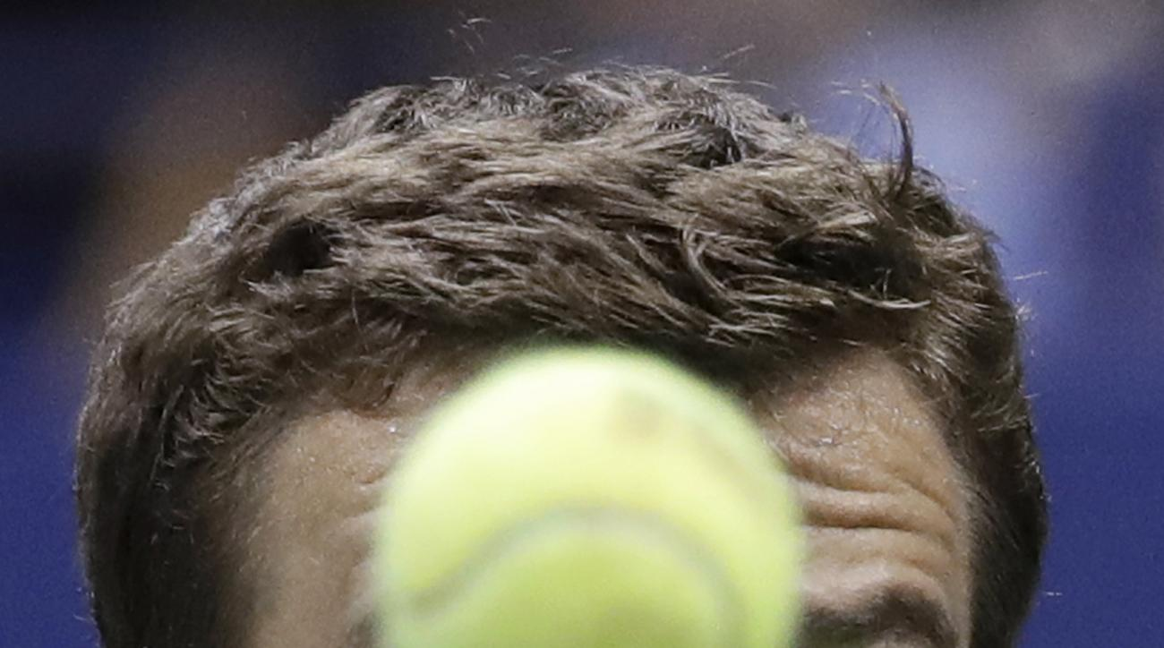 Andrey Kuznetsov, of Russia, eyes a\tne ball before returning a shot to Rafael Nadal, of Spain, during the U.S. Open tennis tournament Friday, Sept. 2, 2016, in New York. (AP Photo/Julio Cortez)