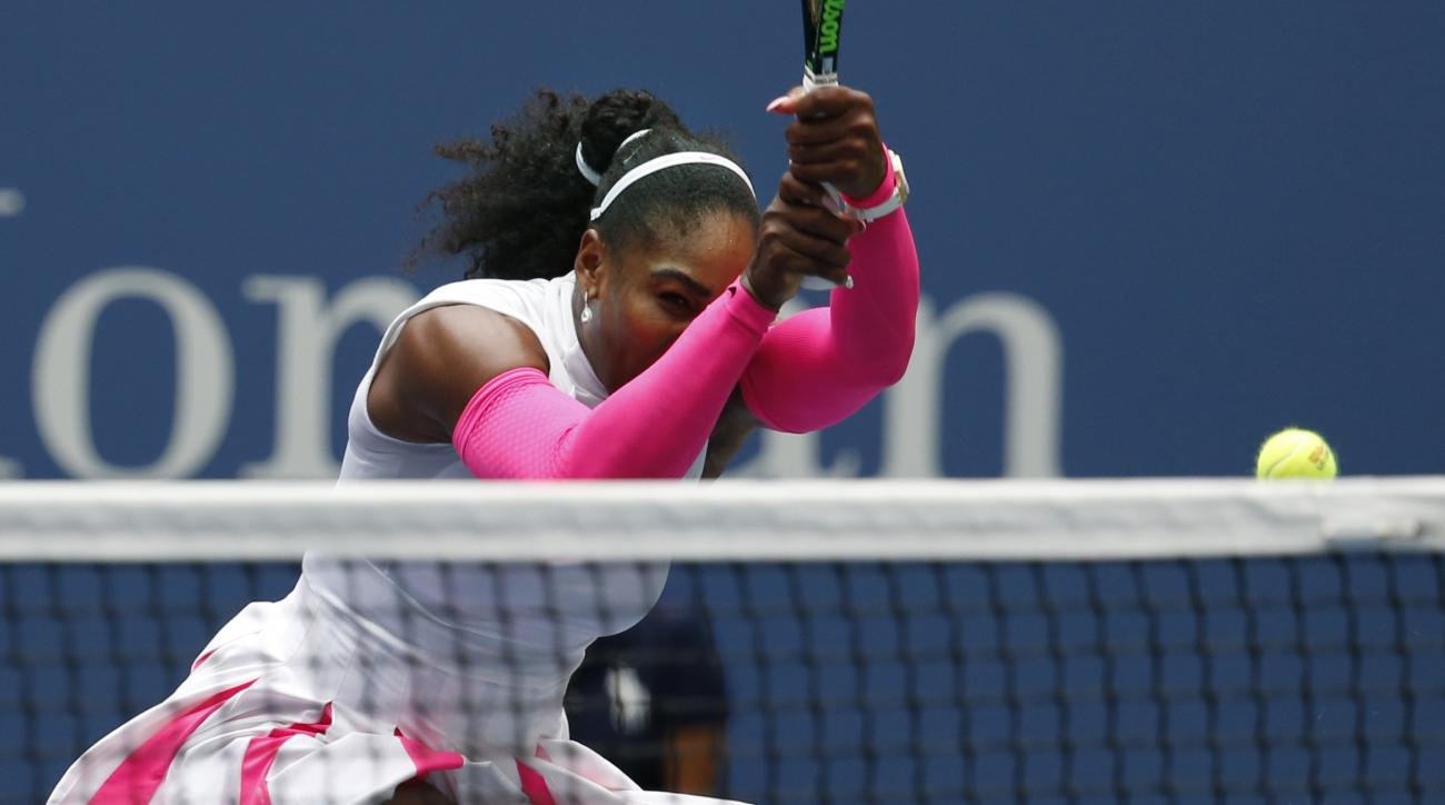 Serena Williams, of the United States, returns a shot to Johanna Larsson, of Sweden, during the third round of the U.S. Open tennis tournament, Saturday, Sept. 3, 2016, in New York. (AP Photo/Jason DeCrow)