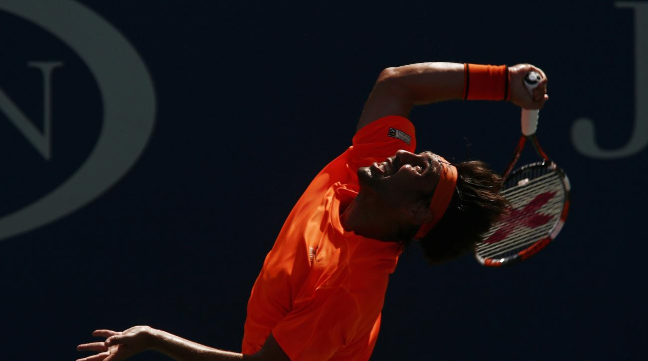 Marcos Baghdatis, of Cyprus, serves to Gael Monfils, of France, during the fourth round of the U.S. Open tennis tournament, Sunday, Sept. 4, 2016, in New York. (AP Photo/Andres Kudacki)