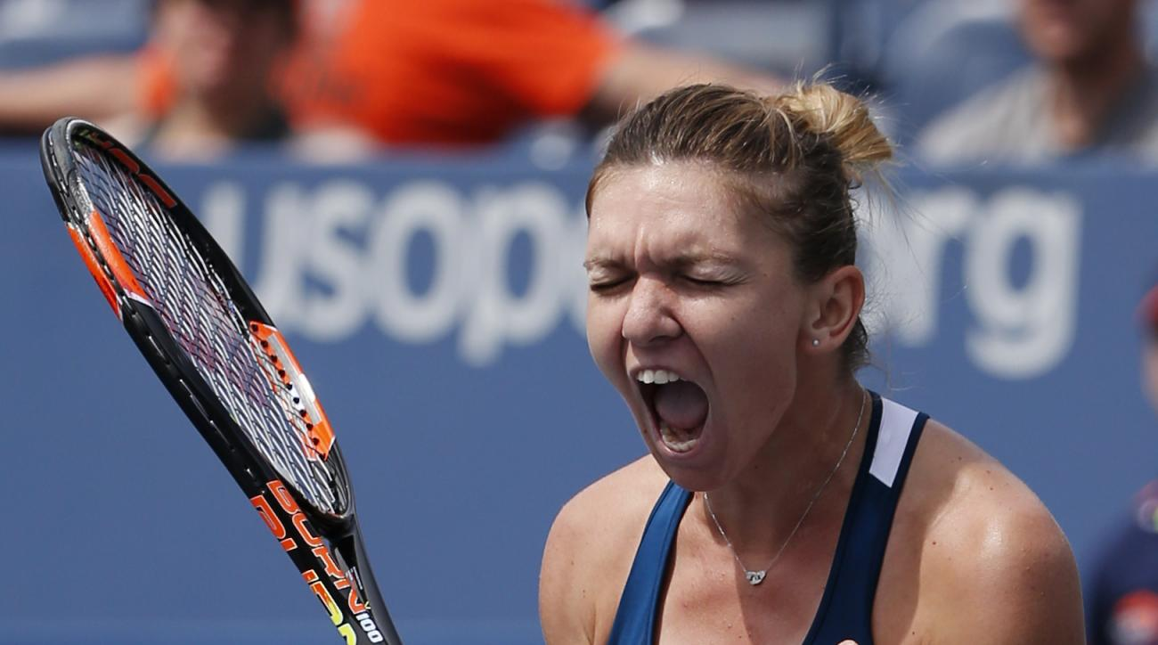 Simona Halep, of Romania, reacts after beating Carla Suarez Navarro, of Spain, during the fourth round of the U.S. Open tennis tournament, Monday, Sept. 5, 2016, in New York. (AP Photo/Kathy Willens)