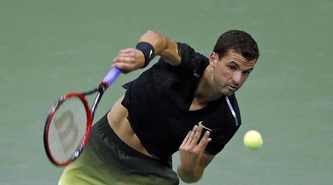 Grigor Dimitrov, of Bulgaria, serves to Andy Murray, of Britain, at the U.S. Open tennis tournament, Monday, Sept. 5, 2016, in New York. (AP Photo/Adam Hunger)
