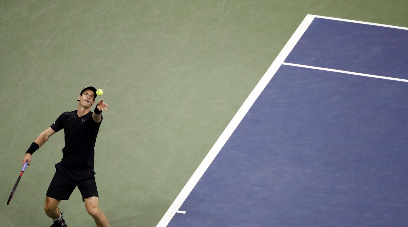 Andy Murray, of Britain, serves to Grigor Dimitrov, of Bulgaria, during the U.S. Open tennis tournament, Monday, Sept. 5, 2016, in New York. Murray won 6-1, 6-2, 6-2. (AP Photo/Adam Hunger)