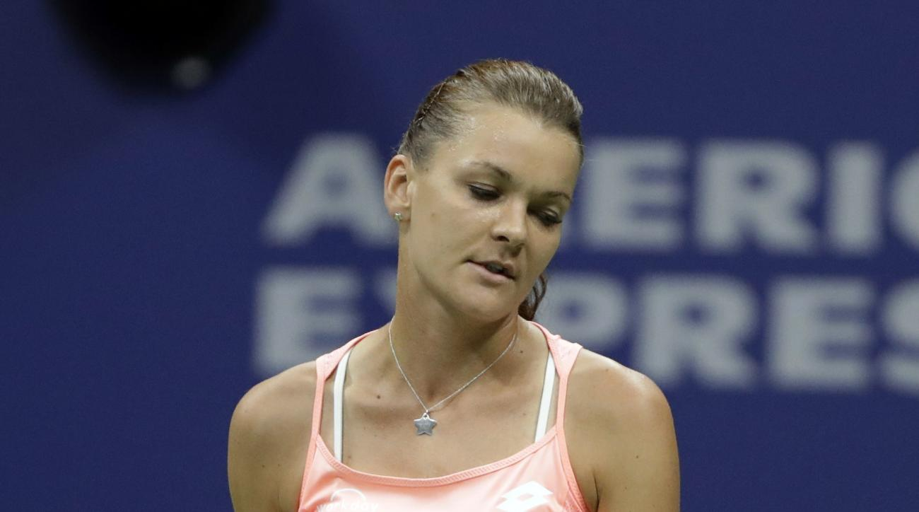 Agnieszka Radwanska, of Poland, reacts after missing a shot against Ana Konjuh, of Croatia, during the U.S. Open tennis tournament, Monday, Sept. 5, 2016, in New York. (AP Photo/Darron Cummings)