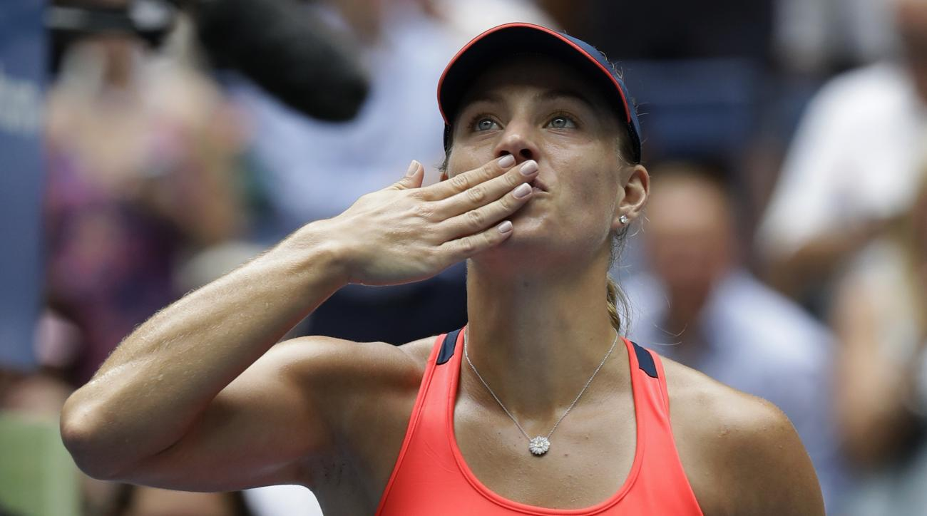 Angelique Kerber, of Germany, blows kisses to the crowd after defeating Roberta Vinci, of Italy, during the quarterfinals of the U.S. Open tennis tournament, Tuesday, Sept. 6, 2016, in New York. (AP Photo/Julio Cortez)