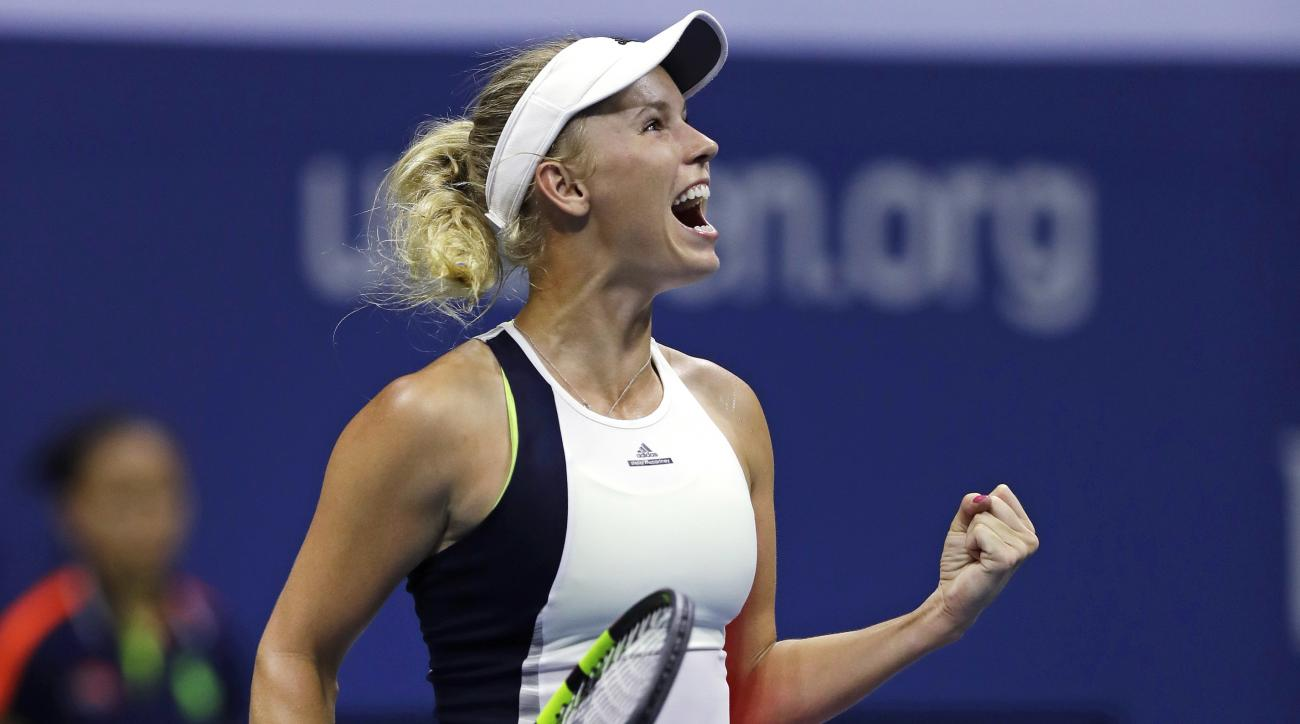 Caroline Wozniacki, of Denmark, pumps her fist after defeating Anastasija Sevastova, of Latvia, 6-0, 6-2 during a quarterfinal at the U.S. Open tennis tournament, Tuesday, Sept. 6, 2016, in New York. (AP Photo/Charles Krupa)