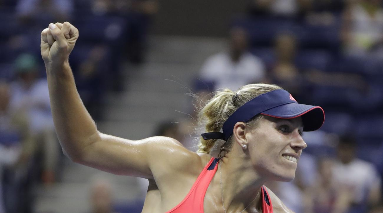 Angelique Kerber, of Germany, reacts after defeating Caroline Wozniacki, of Denmark, during the semifinals of the U.S. Open tennis tournament, Thursday, Sept. 8, 2016, in New York. (AP Photo/Darron Cummings)