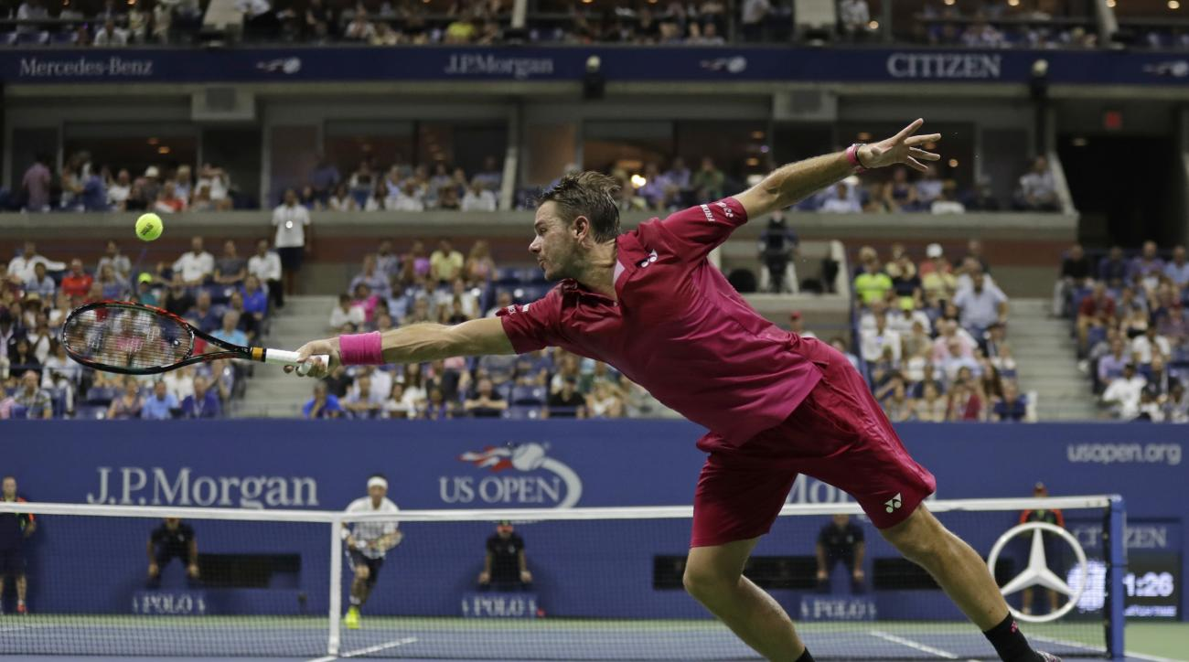 Stan Wawrinka, of Switzerland, returns a shot to Kei Nishikori, of Japan, during the semifinals of the U.S. Open tennis tournament, Friday, Sept. 9, 2016, in New York. (AP Photo/Charles Krupa)