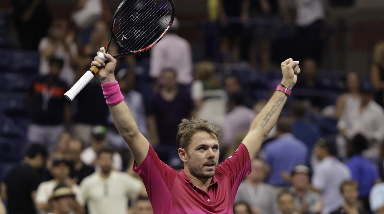 Stan Wawrinka, of Switzerland, reacts after beating Kei Nishikori, of Japan, during the semifinals of the U.S. Open tennis tournament, Friday, Sept. 9, 2016, in New York. (AP Photo/Darron Cummings)