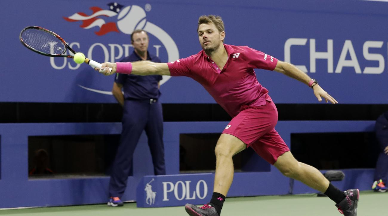 Stan Wawrinka, of Switzerland, returns a shot to Novak Djokovic, of Serbia, during the men's singles final of the U.S. Open tennis tournament, Sunday, Sept. 11, 2016, in New York. (AP Photo/Darron Cummings)