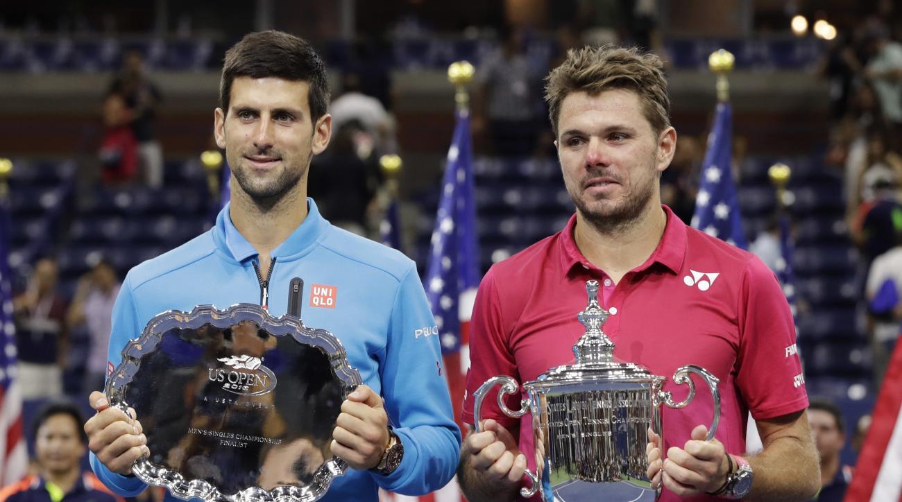 Stan Wawrinka, of Switzerland, right, and Novak Djokovic, of Serbia, pose for a photo after Wawrinka beat Djokovic to win the men's singles final of the U.S. Open tennis tournament, Sunday, Sept. 11, 2016, in New York. (AP Photo/Darron Cummings)