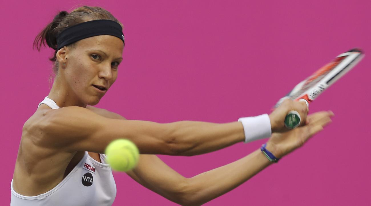 Victoria Golubic of Switzerland returns a shot to Christina Mchale of the United States during their quarter-final match of the Japan Women's Open tennis tournament in Tokyo, Friday, Sept. 16, 2016. (AP Photo/Koji Sasahara)