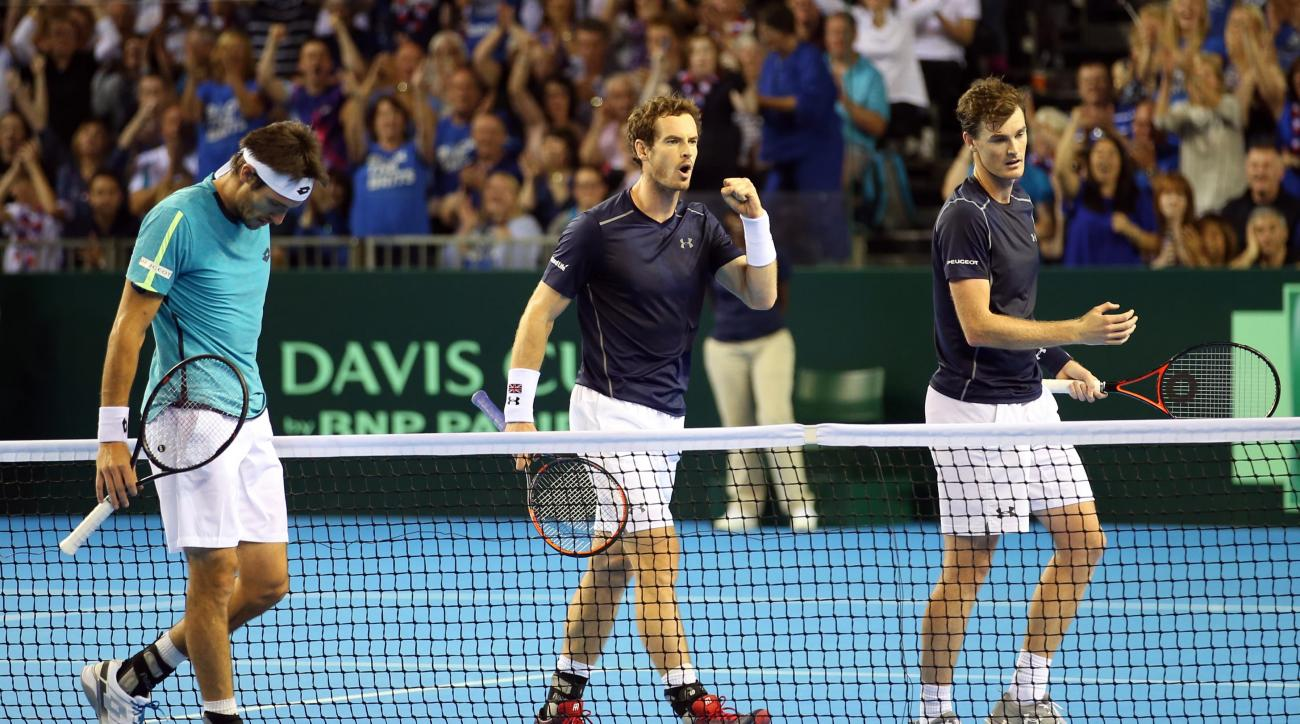 Great Britain's Andy Murray, centre, and Jamie Murray, right, celebrate after claiming the third set against Argentina's Juan Martin del Potro and Leonardo Mayer, right, on day two of the Davis Cup tennis tournament semi-final between Great Britain and Ar
