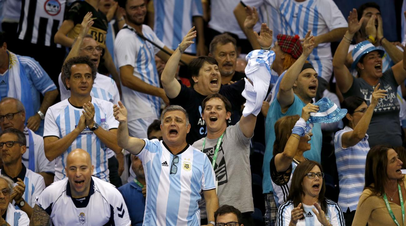 Argentinean tennis fans celebrate in the stands after Argentina's Davis Cup team won over Great Britain during day three of the Davis Cup at the Emirates Arena in Glasgow, Scotland, Sunday Sept. 18, 2016. (Jane Barlow / PA via AP)