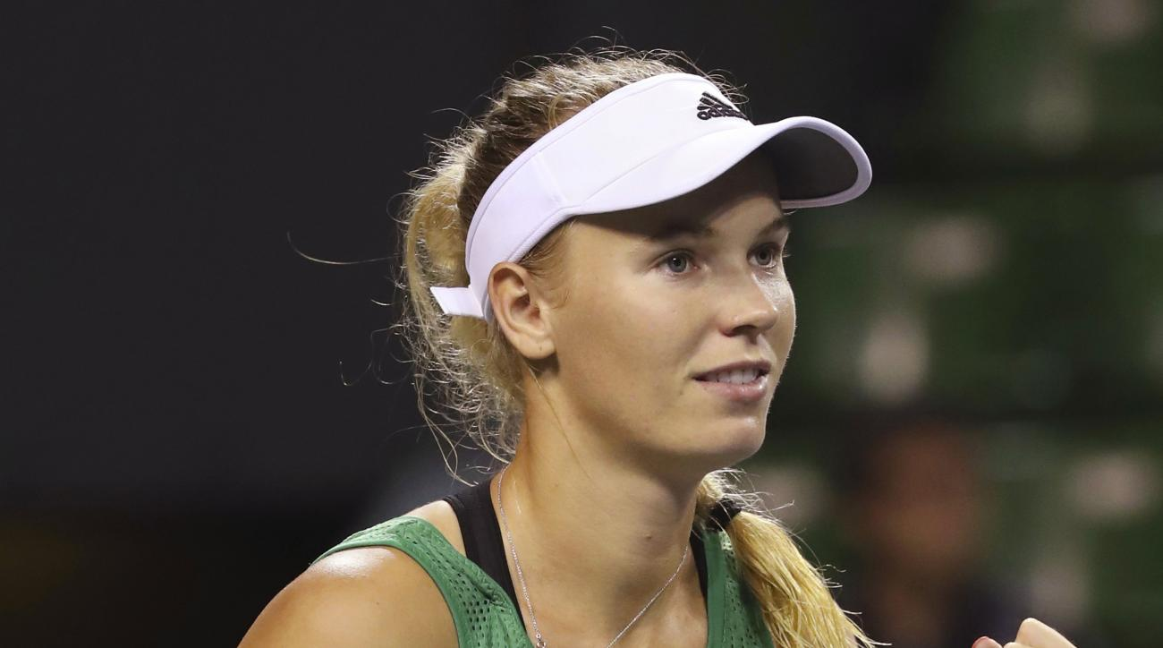 Caroline Wozniacki, of Denmark, celebrates after defeating Belinda Bencic, of Switzerland, during the women's singles match at the Pan Pacific Open women's tennis tournament in Tokyo, Tuesday, Sept. 20, 2016. (AP Photo/Eugene Hoshiko)