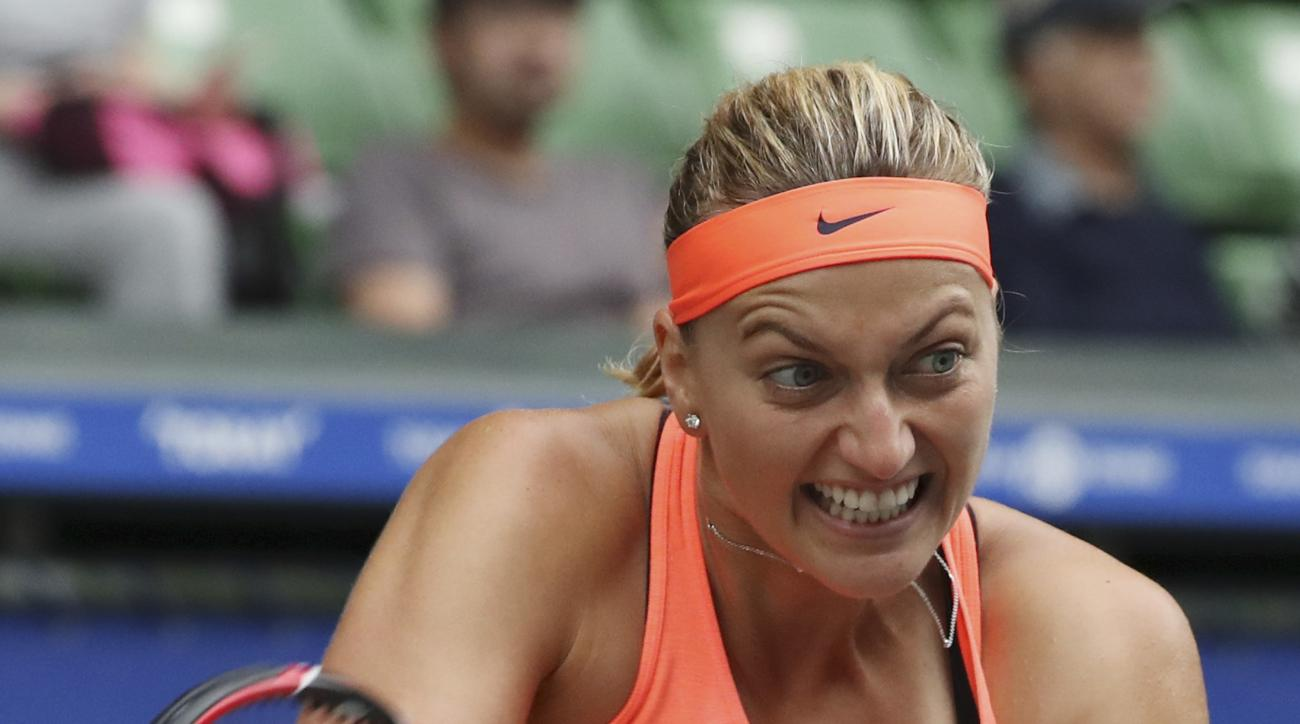 Petra Kvitova, of the Czech Republic, returns a shot against Monica Puig, of Puerto Rico, during the women's singles match at the Pan Pacific Open women's tennis tournament in Tokyo, Wednesday, Sept. 21, 2016. (AP Photo/Eugene Hoshiko)